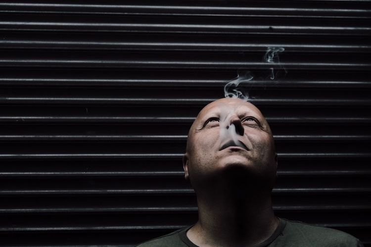 Neon alley Neon Smoking Smoke One Person Headshot Portrait Lifestyles Indoors  Front View Real People Men Adult Close-up Blinds Looking Body Part Leisure Activity Mid Adult Human Face Contemplation Pattern Focus On The Story #FREIHEITBERLIN The Portraitist - 2018 EyeEm Awards The Troublemakers