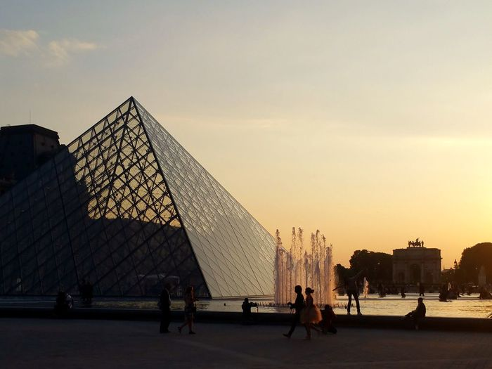 I'm not usually one to whip out a camera to capture tourist attractions, but the sunset reflecting off of the glass melted my heart and made me want to capture the moment forever. That, and the Parisian wine made me a lot more easygoing. Paris Romantic Louvre Sky Real People Group Of People Sunset Built Structure Architecture Nature Tourism Travel Destinations My Best Travel Photo