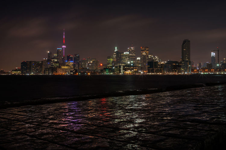 Toronto skyline seen from Polson Pier Long Exposure Architecture Building Exterior City Night Built Structure Water Illuminated Landscape Skyscraper Urban Skyline Cityscape Waterfront Tall - High Modern No People Office Building Exterior Building Toronto Dark Low Angle View Pier Reflections Ice CN Tower