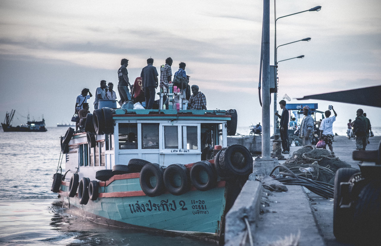 large group of people, transportation, real people, men, sky, water, day, sea, nautical vessel, mode of transport, cloud - sky, outdoors, women, nature, people