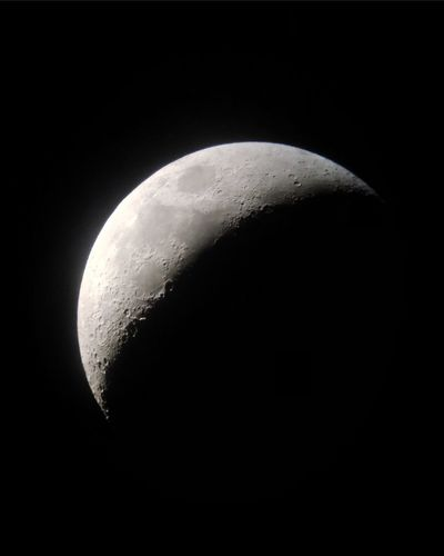 Close-up of moon over black background