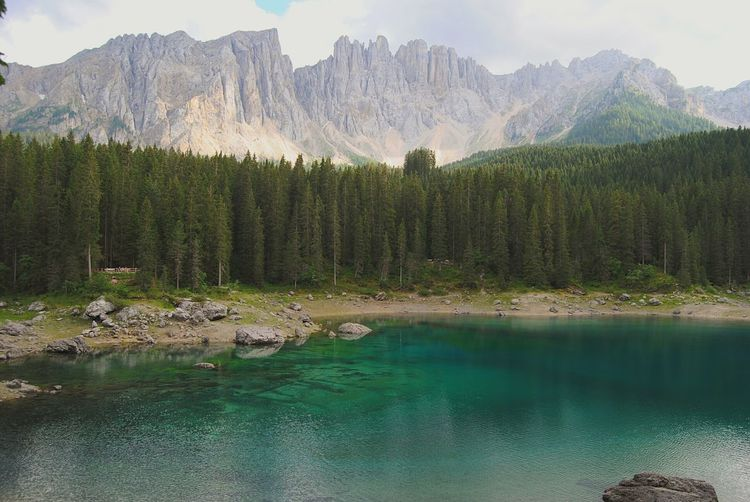 Scenic view of lake carezza by mountain