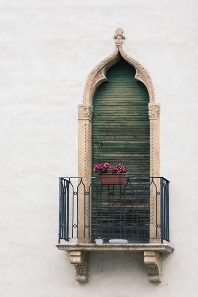 An ornate window with green shutter Green Shutters Architecture Flower Juliet Balcony Ornate Shuttered Window
