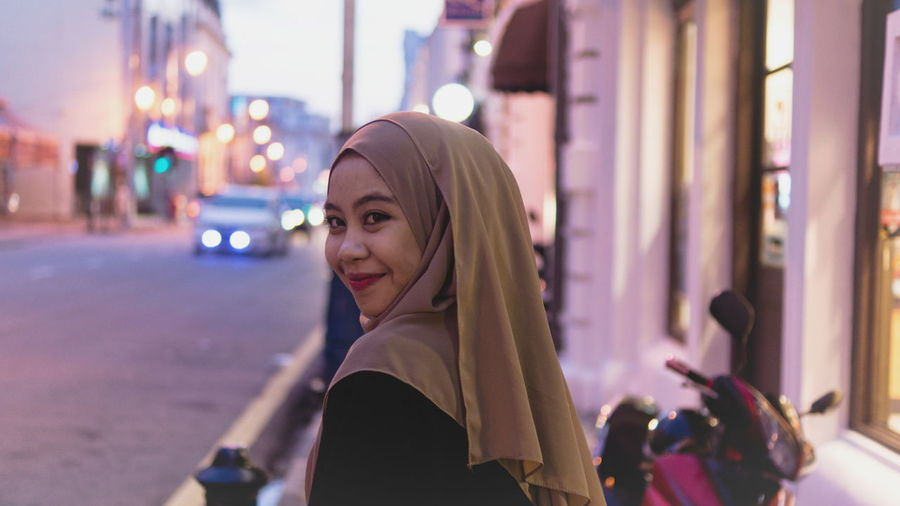 Smiling Woman Wearing Hijab During Sunset