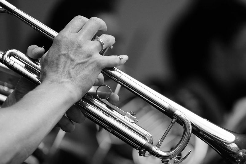 Close-up of man playing trumpet