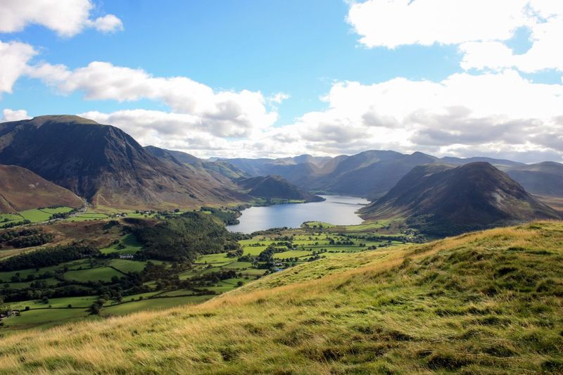Crummock water lake amidst mountains against sky at cumbria