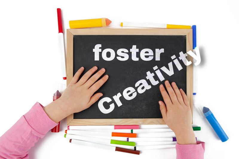 Creativity Design Holding Isolated On White Background Black Blackboard  Board Chalkboard Child Childhood Childs Hand Concept Conceptual Concern Education Foster Girl Isolated Issues Let's Letters Message Spanish Spanish For Kids Talk Text Top View Typography Unrecognizable Person White Writing Young
