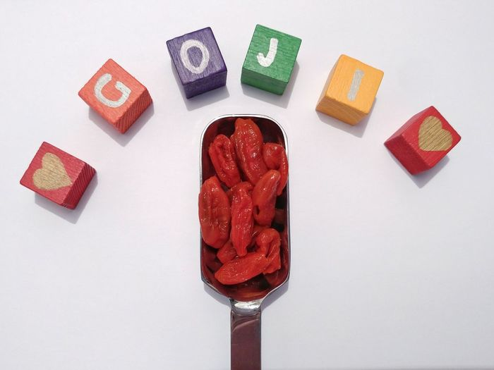 White Background No People Red Superfood Love High Angle View Eat Flatlay Text Nutrition Health Healthy Eating Food Delicious Yum Goji Berries Goji Multi Colored Red Indoors  Directly Above Studio Shot