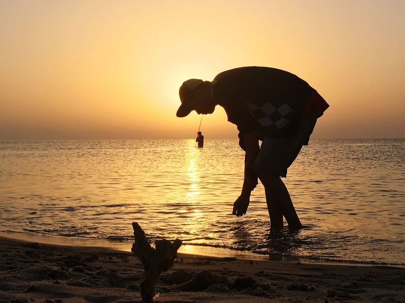 Sunset Silhouette Sea Beach Nature Water Standing People One Man Only Horizon Over Water Full Length Beauty In Nature Sun Outdoors Sky Men Tranquility Scenics One Person Adult