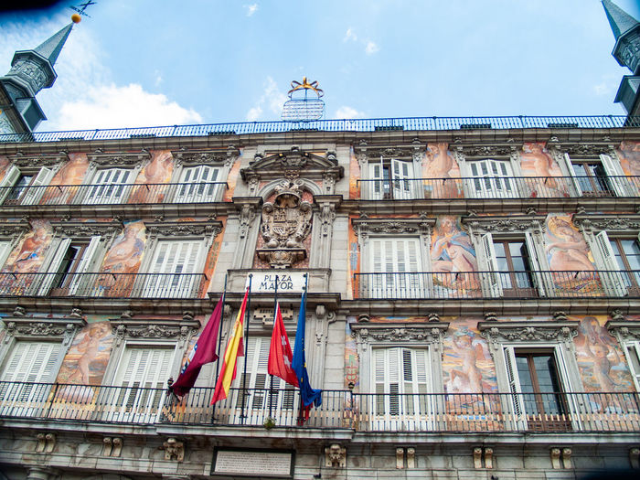 City Construction Madrid Place Plaza Mayor (Madrid). Travel Traveling Urban Lifestyle Apartment Architectural Detail Architecture Balcony Building Building Exterior Built Structure City Cloud - Sky Day Facades Flag History Lifestyles Low Angle View Luxury Nature No People Ornaments Ornate Outdoors Patriotism Residential Building Sky Still Life The Past Tourism Tourist Destination Town Travel Travel Destinations Urban Window