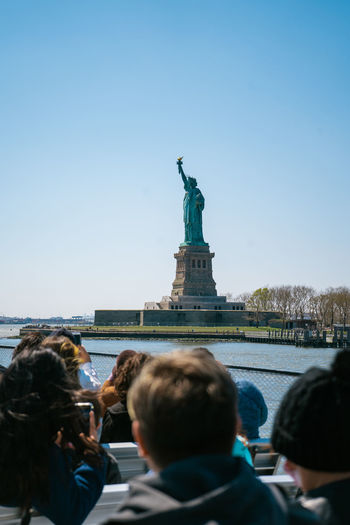 Boat going towards the statue of liberty, new york.