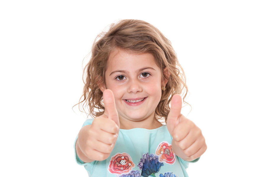 Young girl showing thumbs up. All on white background. Child Childhood Compliment Curly Hair Gesture Girl Girlhood Hand Sign Isolated On White Isolated White Background Kid One Person Positive Energy  Recommendation Smiling Studio Shot Thumbs Up White Background Young Girl