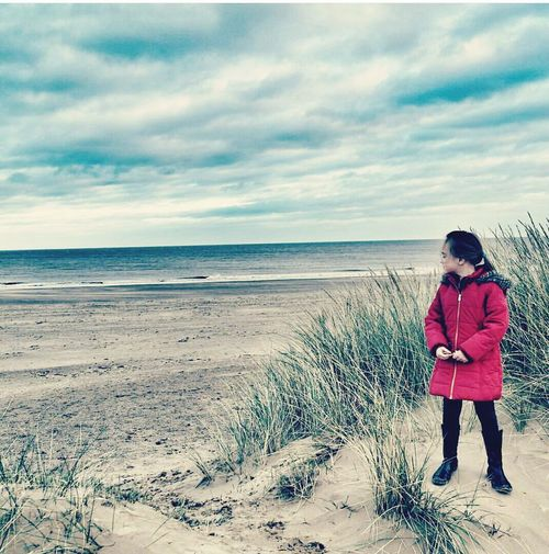 Daughter on the beach Beach Sea One Person Sand Full Length People Horizon Over Water Nature Beauty In Nature Outdoors Standing Adult Sky