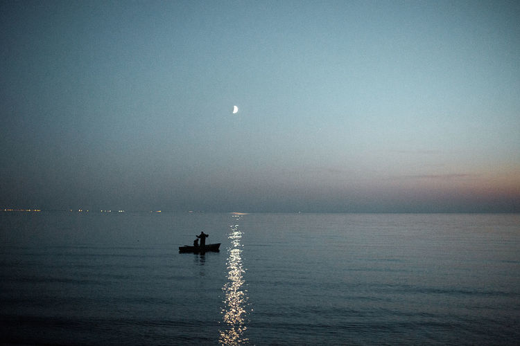 Sky Water Transportation Sea Nautical Vessel Beauty In Nature Scenics - Nature Horizon Over Water Mode Of Transportation Moon Horizon Waterfront Nature Tranquility Tranquil Scene Sunset Real People Unrecognizable Person Dusk Outdoors Capture Tomorrow