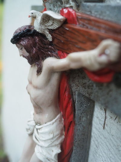 Grave Graveyard Beauty Jesus Jesus Christ Jesus Loves You Close-up Day Domestic Animals Gravestone Graveyard Human Body Part Human Hand Leisure Activity Lifestyles Mammal Men One Animal One Person Outdoors People Real People Red Women Young Adult