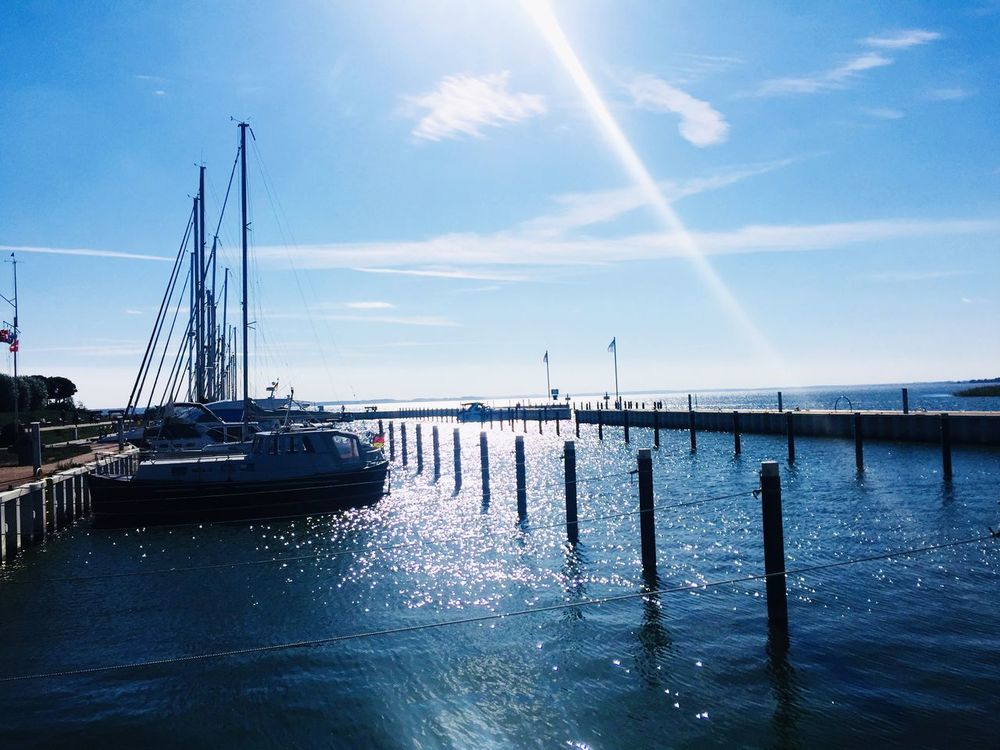 Achterwasser Sky Transportation Water Sea Nature Mode Of Transportation Nautical Vessel Cloud - Sky No People Day Scenics - Nature Sunlight Beauty In Nature Architecture Outdoors Sailboat Vapor Trail Travel Built Structure Waterfront