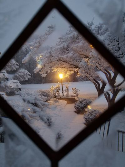 View of illuminated glass window in winter