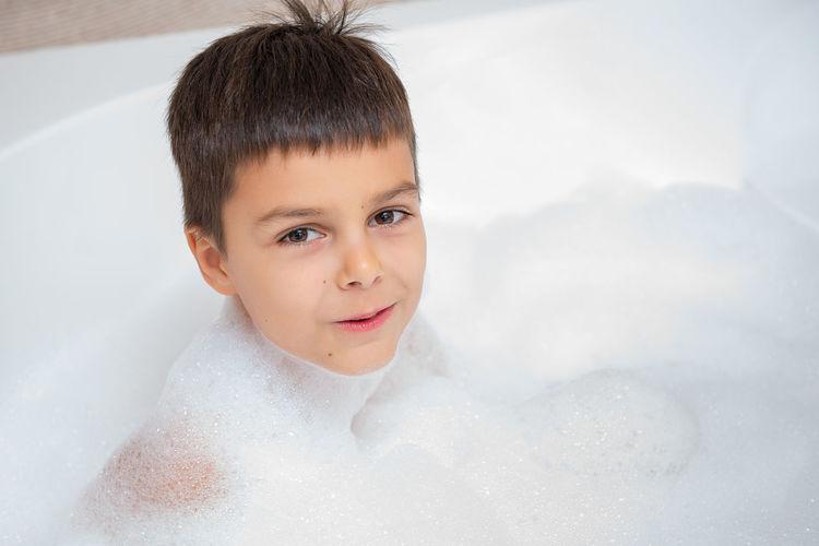 Portrait Of Smiling Boy In Bathroom