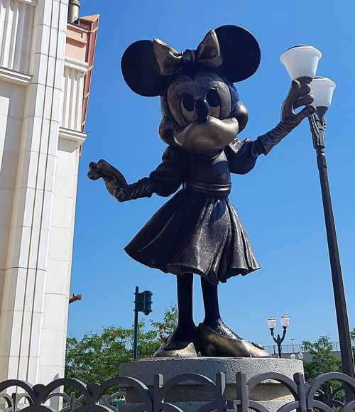"Here is a Photo Shot of a Statue of Minnie Mouse. This Photo was taken in the Disney Village just outside of the ""World of Disney"" Souvenir Shop. 2017 2017 Year 25th Anniversary Disneyland Paris DLRP France Disney Disneyland Paris Disneyland Paris 💚🎆🗼 Disneyland Resort Paris Disneyland Resort Paris 2017 Eurodisney Minnie Mouse Minniemouse Architecture Building Exterior Built Structure City Day Disney Village Disneylandparis No People Outdoors Sculpture Sky Statue Theme"