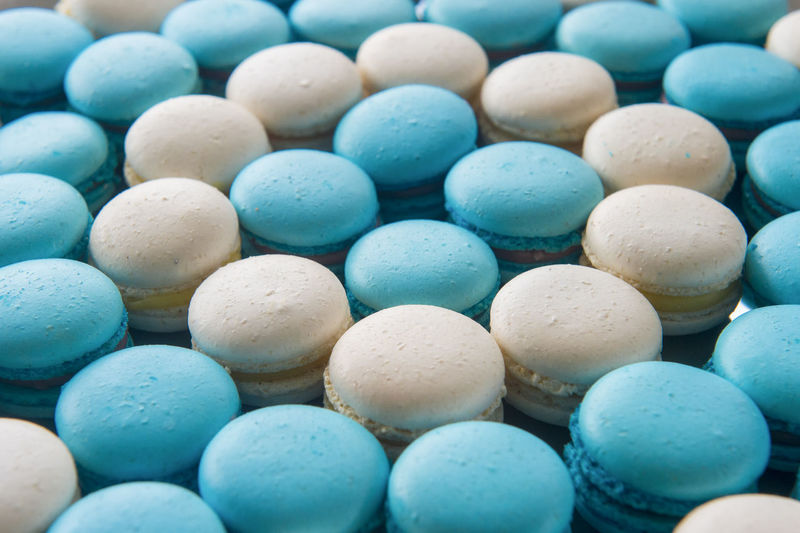 Blue and white macarons Macarons Abundance Arrangement Backgrounds Blue Candy Choice Close-up Day Food Food And Drink Full Frame Indulgence Large Group Of Objects Macaroon Multi Colored No People Pebble Still Life Sweet Sweet Food Temptation Unhealthy Eating