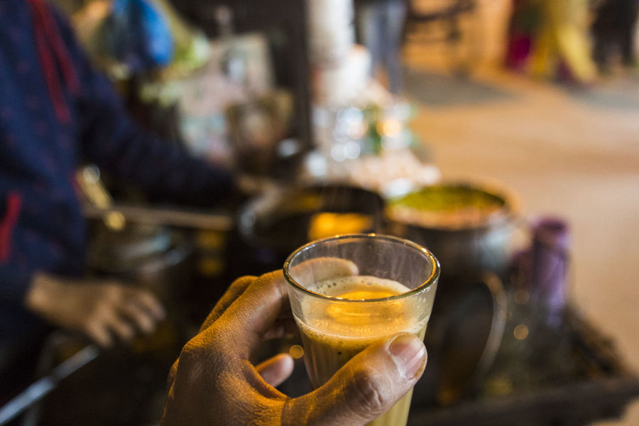 close up of glass of indian tea in hand Chai Chai Tea Chai Time Close-up Focus On Foreground Heat - Temperature Hot Drink Indian Culture  Indian Tea Indianstories Indiapictures Night Street Refreshment Selective Focus