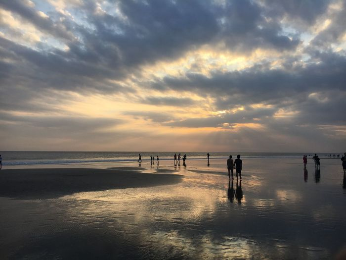 Sunset at Bali Water Sky Beach Sea Land Cloud - Sky Sunset Group Of People Large Group Of People Beauty In Nature Outdoors Reflection Nature