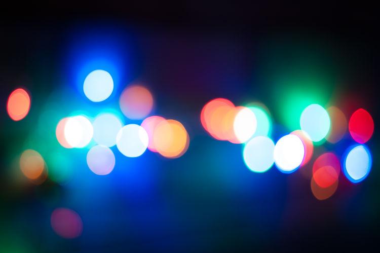 colors Illuminated Night Defocused Geometric Shape Circle Shape No People Glowing Lighting Equipment Multi Colored Light Light - Natural Phenomenon Electric Light Pattern Outdoors Lens Flare Light Effect Backgrounds Street City Nightlife