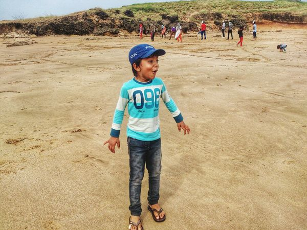 Sand Childhood Child Beach Boys Standing One Person Full Length Outdoors One Boy Only Sand Dune Sand Pail And Shovel Children Only Wow!!😋 Feeling Happy Happiness♥ Family