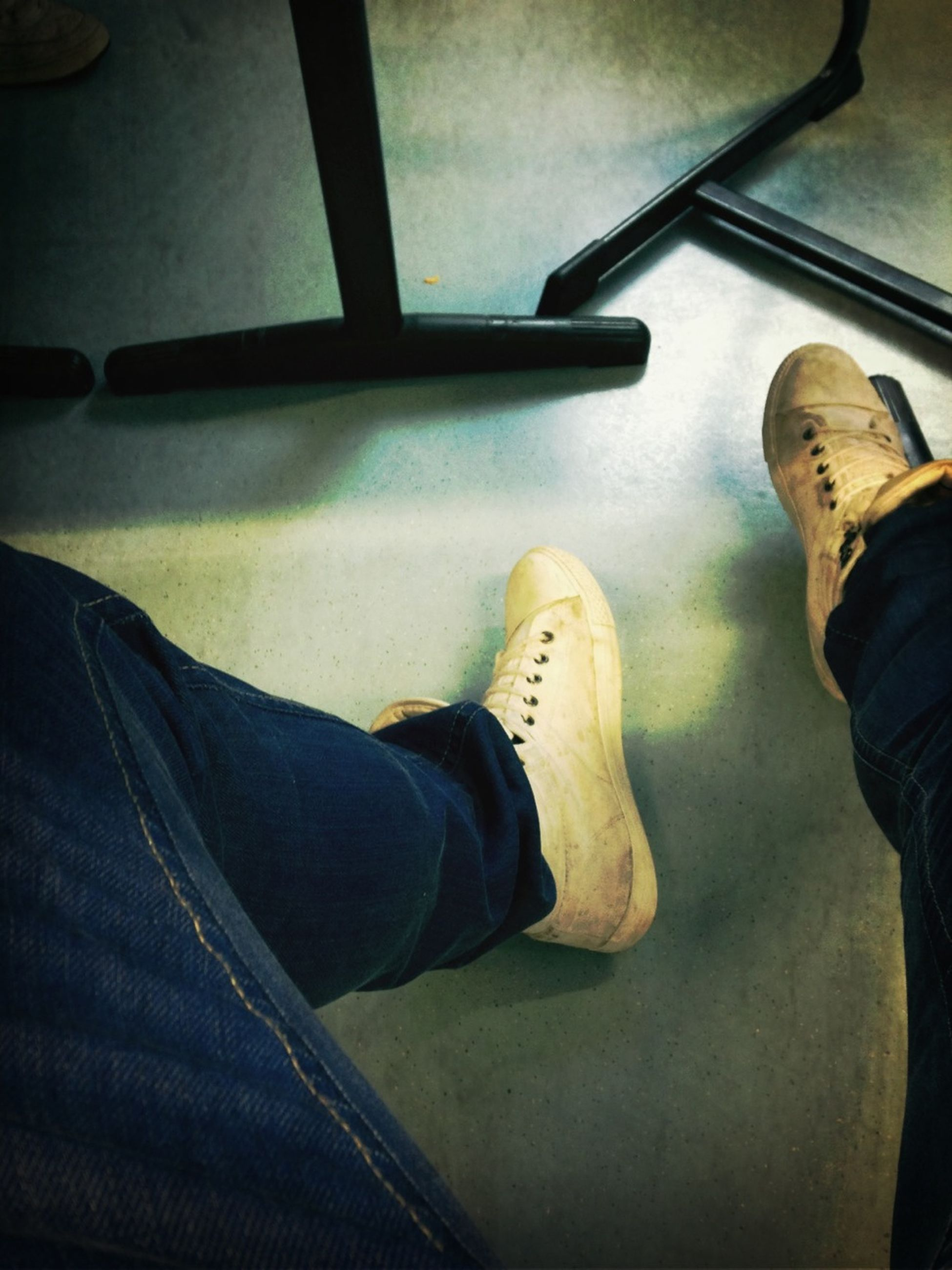 low section, person, shoe, indoors, personal perspective, lifestyles, men, standing, jeans, human foot, leisure activity, footwear, casual clothing, high angle view, unrecognizable person, part of, canvas shoe