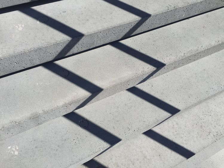 Shadow Sunlight High Angle View Flooring Focus On Shadow Repetition Outdoors Geometric Shape No People Stone Material Concrete Precast Concrete The Graphic City