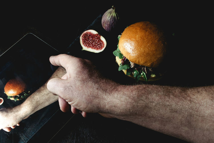 Double Exposure Of Man Hand And Meal On Table