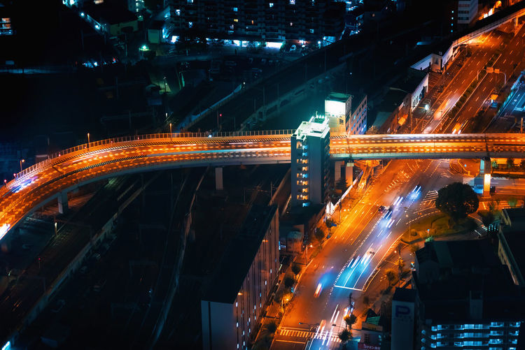 Aerial view of light trails on road at night