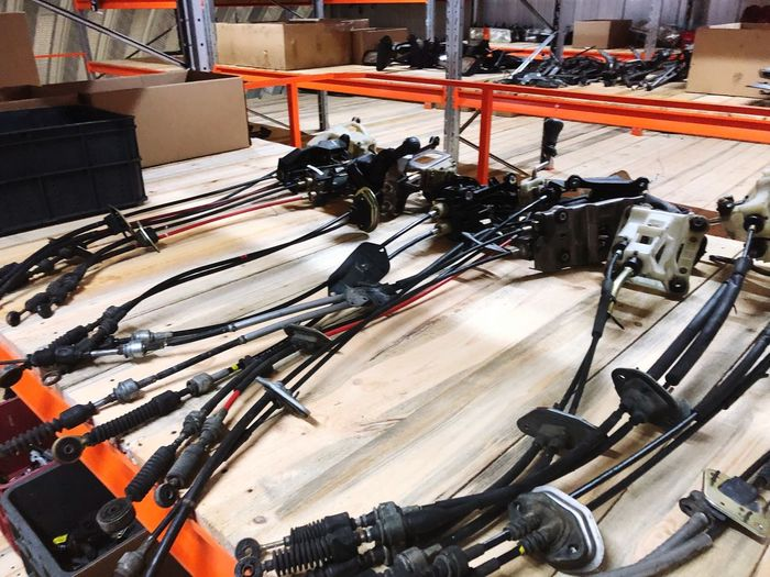 High Angle View Of Machineries On Tale In Workshop