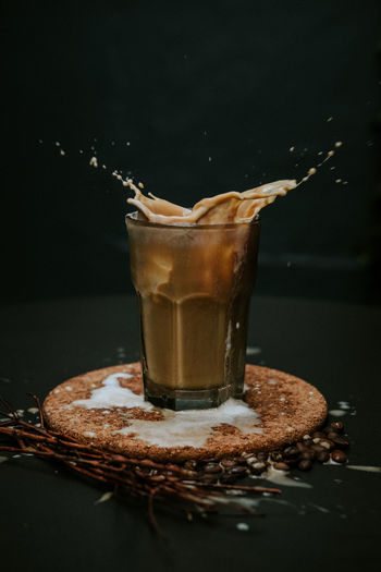 Close-up of coffee splashing in glass