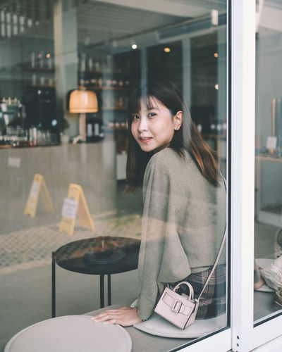Chilling One Person Real People Smiling Young Adult Young Women Casual Clothing Looking At Camera Happiness Lifestyles Glass - Material Waist Up Emotion Women Restaurant Portrait Adult Business Leisure Activity Hairstyle Hair Beautiful Woman
