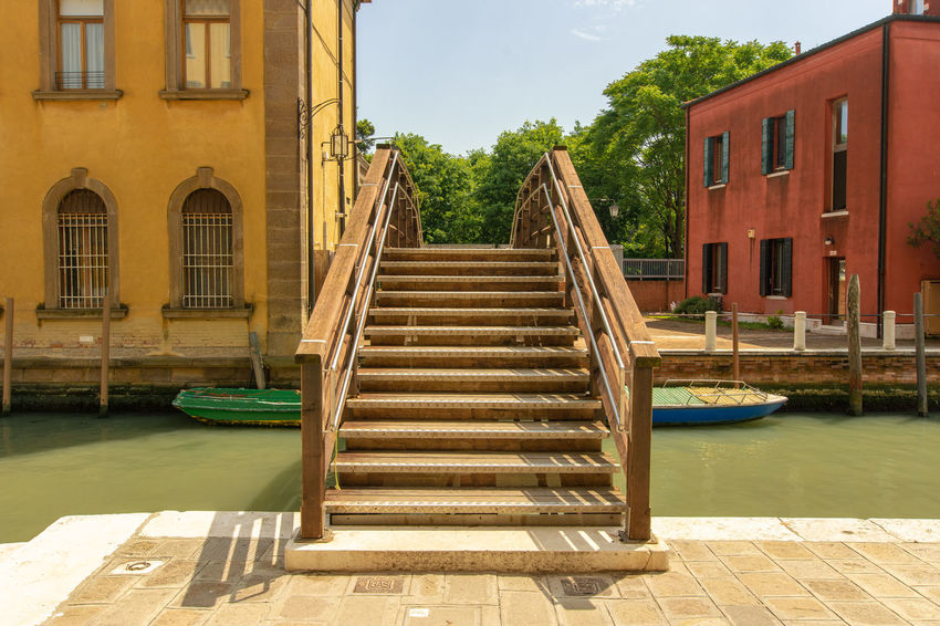 a wooden bridge in Venice Wood Bridge Canal Italy Residential District Venice Waterfront Way Wood - Material