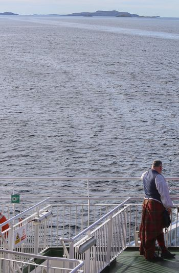 Man on Ferry man in Tartan going to the Highland Outlander Kilt Tartan Unrecognizable Person Highlands Travel Photography VisitScotland Highlands Of Scotland Men Rear View Real People Lifestyles One Person Water Nature Day Leisure Activity Beauty In Nature Full Length Sea Adult Outdoors Scenics - Nature Sky Railing