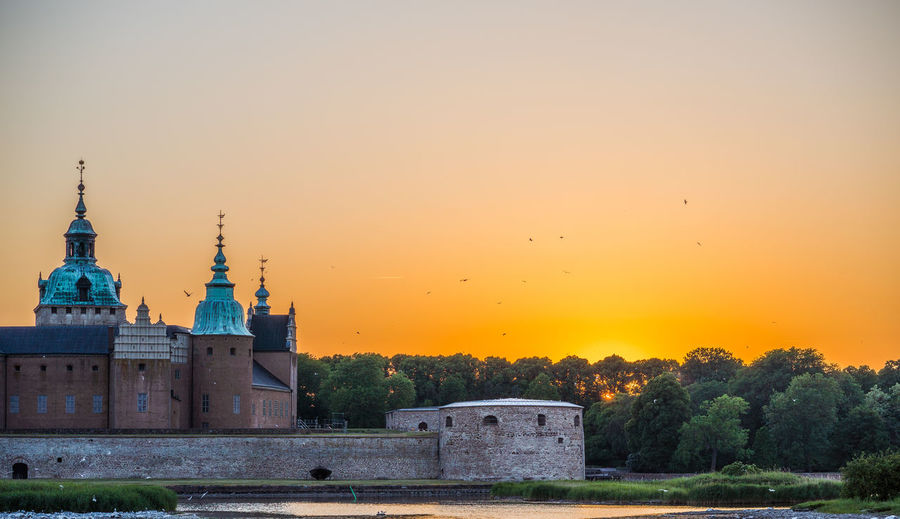 Castle Architecture Building Building Exterior Built Structure History Kalmar Nature No People Orange Color Place Of Worship Plant Sky Sunset The Past Tower Travel Destinations Tree