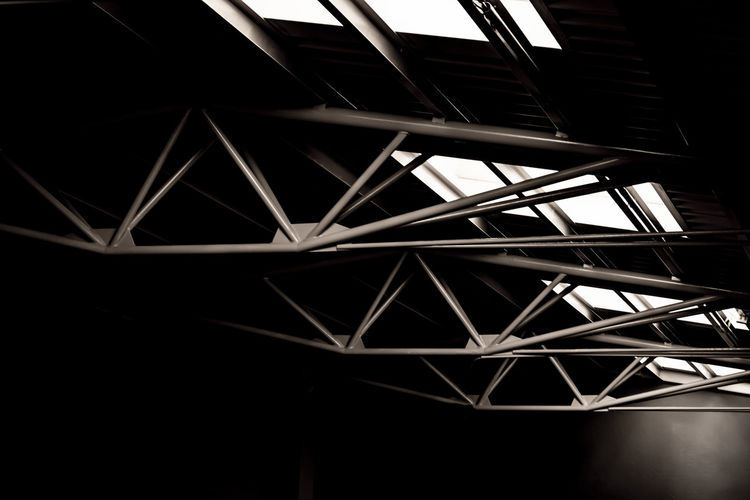 Retro Built Structure in Switzerland. Architecture Light Old-fashioned Part Of Retro Sunlight Architectural Feature Architecture Built Structure Ceiling Close-up Connection Dark Girder Illuminated Indoors  Industry Light Effect Low Angle View Metal No People Old Pattern Retro Styled Roof Beam