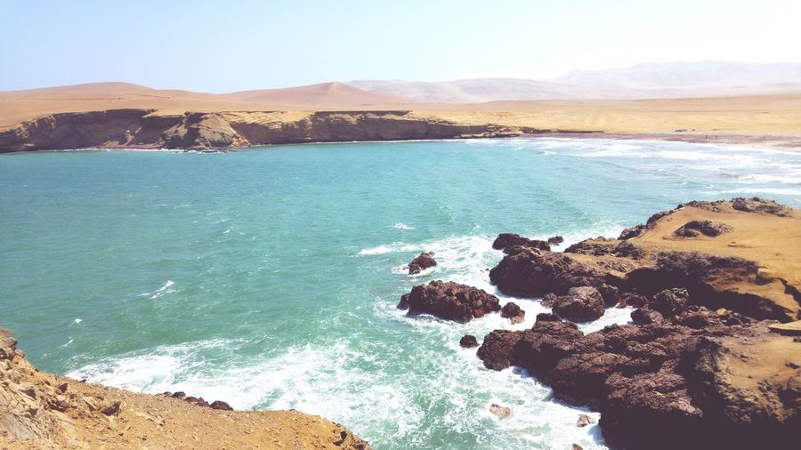 Paracas in beautiful Perú Sea Beach Water No People Sand Nature Landscape Outdoors Day Mountain Scenics Horizon Over Water Sky Beauty In Nature Wave Seascape Travel Destinations First Eyeem Photo Beauty In Nature Nature High Angle View Peru Paracas Paracas National Park