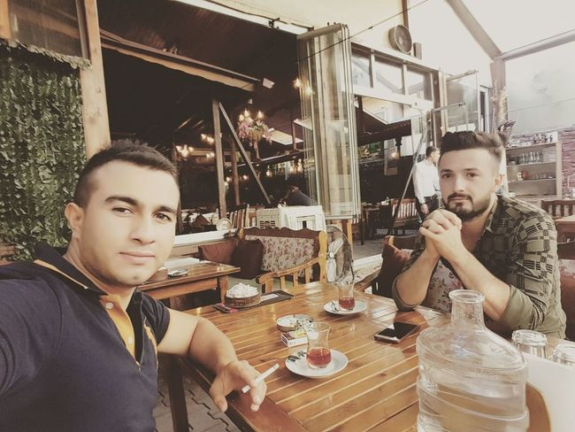 İce tea Table Only Men Adults Only Young Men Two People Young Adult Togetherness People Sitting Adult Men Friendship Indoors  Casual Clothing Happiness Bar - Drink Establishment Beard Day Lifestyles Real People