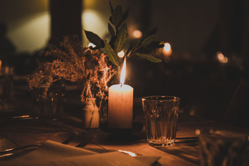 Candle Burning Fire Flame Fire - Natural Phenomenon Indoors  Table Illuminated No People Nature Heat - Temperature Selective Focus Close-up Focus On Foreground Glass Glass - Material Glowing Plant Celebration Decoration Dark Tea Light Setting Luxury Holiday Moments