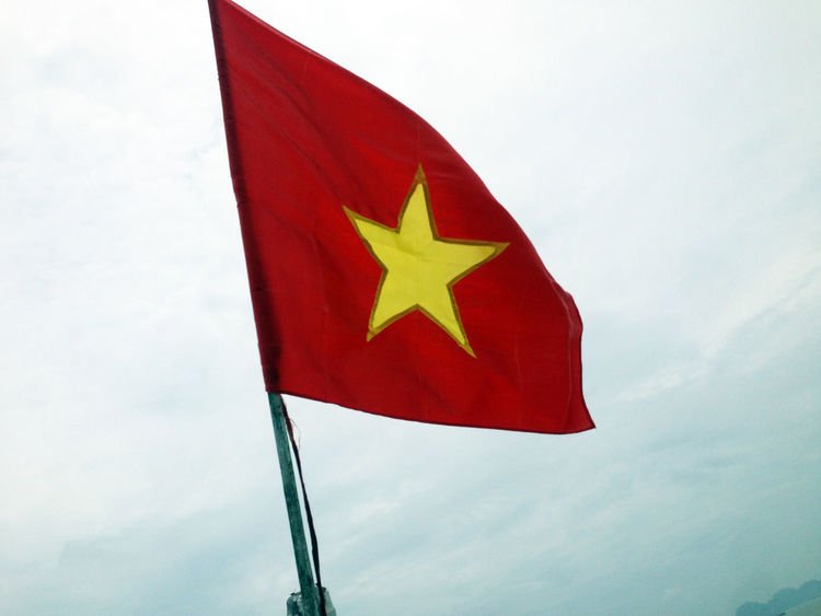 Vietnam Flag, Halong Bay boat cruise, Vietnam Clear Background Close-up Day Flag Halong Bay Vietnam Low Angle View No People Outdoors Patriotism Red Sky Vietnam Flag Vietnam Trip Yellow Star