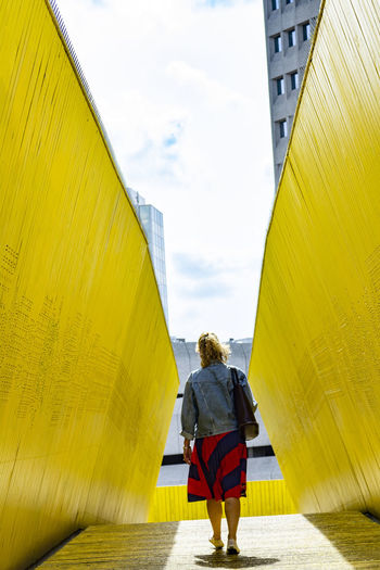 Adult Architecture Building Building Exterior Built Structure Cloud - Sky Day Full Length Leisure Activity Lifestyles Nature One Person Outdoors Real People Rear View Sky Walking Women Yellow #urbanana: The Urban Playground #urbanana: The Urban Playground International Women's Day 2019