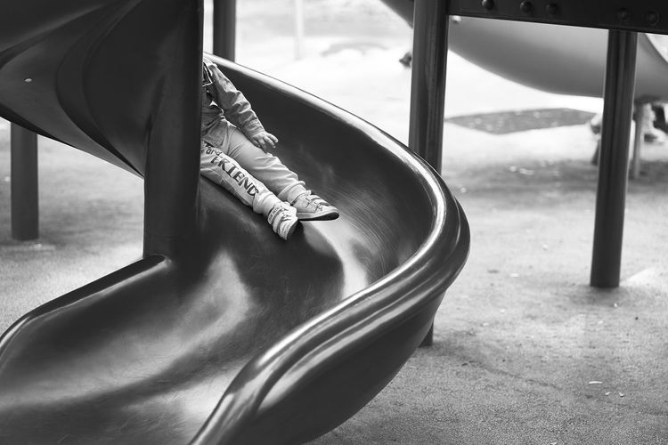 Low section of child sitting in playground