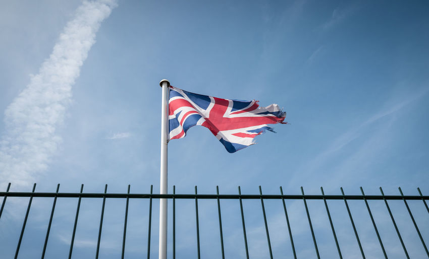 Low Angle View Of British Flag Waving Against Sky