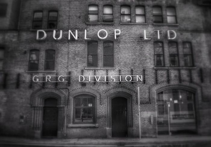 Old Dunlop GRG Division factory on Cambridge Street now appartments, Manchester Malephotographerofthemonth Monochrome Photography Creative Light And Shadow Creative Light And Shadow Color Photography Landscape_photography Blackandwhite Photography Black And White Photography Streets Of Manchester Old Buildings Not Forgotten Architecture Built Structure Building Exterior No People Outdoors
