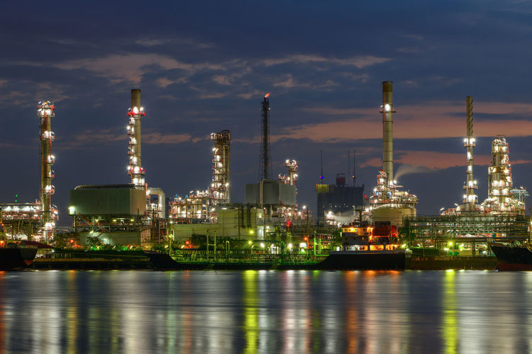 Oil Refinery, Chemical & Petrochemical plant Industry Sky Illuminated Architecture Built Structure Factory Waterfront Building Exterior Cloud - Sky Water Fuel And Power Generation Nature Oil Industry Reflection Refinery No People Outdoors