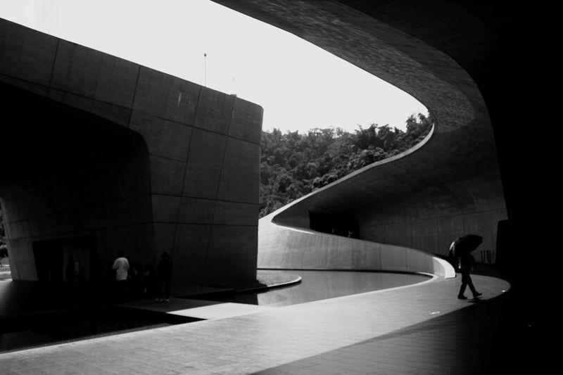 People walking on silhouette of building