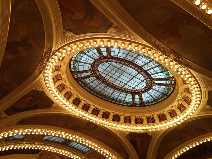 Low angle view of illuminated municipal house ceiling